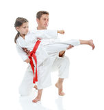 Dad helps daughter learn beat kick leg. Sport family dad helps daughter learn beat kick leg Stock Photography