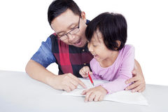 Dad helps his daughter to study Royalty Free Stock Photography