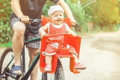 Dad with his daughter on a bike royalty free stock photography