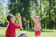 Dad and his daughter are making bubbles Stock Photo