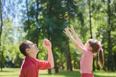 Dad and his daughter are making bubbles Stock Photography