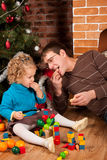 Dad and his daughter near Christmas tree Stock Photos