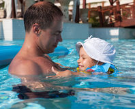 Dad with his daughter in the pool Stock Photo