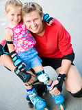 Dad with his daughter on the skates Stock Photo