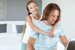 Dad with his daughter using laptop. Stock Photo
