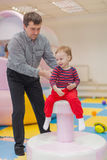 Dad and his little son playing on children's holiday Royalty Free Stock Photos