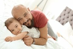 Dad and his little son spending time together. At home stock images
