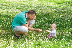 Dad and his little toddler daughter outdoors Royalty Free Stock Images