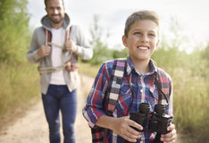 Dad with his son exploring new places Stock Image