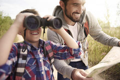 Dad with his son exploring new places. Family exploring new places on nature Royalty Free Stock Images