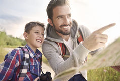 Dad with his son exploring new places Stock Photography