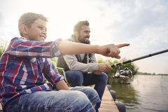 Dad with his son fishing together Stock Photos