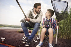 Dad with his son fishing together Royalty Free Stock Image
