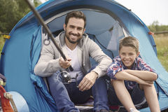 Dad with his son fishing together. If we want to eat dinner we must hunt it Royalty Free Stock Images