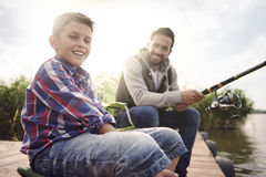 Dad with his son fishing together Royalty Free Stock Images