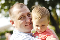 Dad and his son. On outdoor royalty free stock image