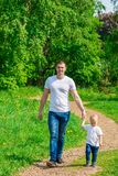 Dad with his son for a walk. In the park stock photo