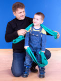 Dad and his young son playing and smiling. Studio shot stock photo