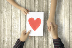 Dad holding greeting card and child hand Stock Images