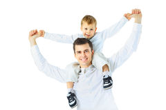 Dad holding his son on his shoulders, Stock Images
