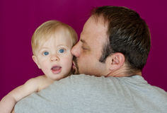 Dad holding infant son Stock Image