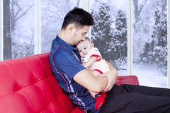 Dad holds his baby to make a good relation Stock Photo
