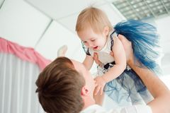 Dad hugging and kissing his little daughter. royalty free stock image