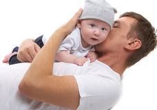 Dad hugs baby son Royalty Free Stock Images
