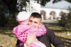 Dad hugs his daughter stock images