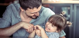 Dad hugs a little daughter royalty free stock photos
