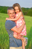 Dad keeps girl. Royalty Free Stock Photos
