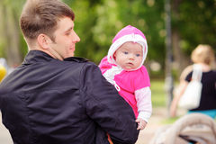 Dad keeps on hand a small child. Royalty Free Stock Photography