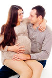 Dad keeps his pregnant wife on her knees Royalty Free Stock Photography