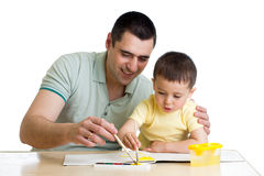 Dad and kid boy paint together. Father and kid boy paint together Stock Photos