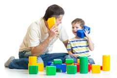 Dad and kid boy role-playing together Royalty Free Stock Images
