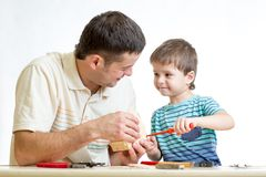 Dad and kid boy working together. Dad and kid boy working isolated on white background royalty free stock photography