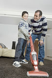 Dad and kid cleaning Royalty Free Stock Photo
