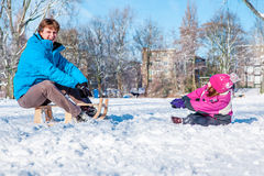 Dad and kid in a snowy park. Cheerful dad and kid in a snowy park Stock Photos
