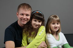 Dad with kids Stock Image