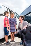 Dad with kids buying family car at dealer Stock Photo