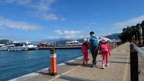 Dad and kids, Port, Boat, Sun Moon Lake, Taiwan. Sun Moon Lake(Chinese:日月潭;pinyin:Rìyuè tán;Pe̍h-ōe-j royalty free stock photography