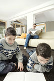 Dad and kids reading on weekend Stock Photo