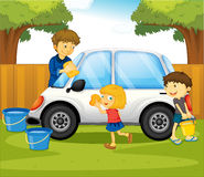 Dad and kids washing car in the park Royalty Free Stock Image