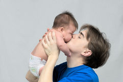 Dad kisses a child stock images