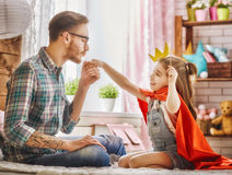 Dad kisses hand of his daughter Royalty Free Stock Images