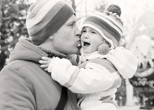 Dad kissing daughter Stock Photography