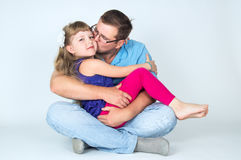 Dad kissing his daughter to. Daddy kisses and hugs his daughter to Royalty Free Stock Image