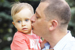 Dad kissing his son. On outdoor Stock Photos