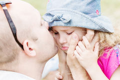 Dad kissing and soothes daughter Royalty Free Stock Images