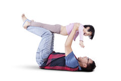 Dad lifting his child in the studio Stock Photography
